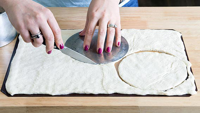 Unroll your pizza dough into one layer. Then cut out three 6-inch circles.