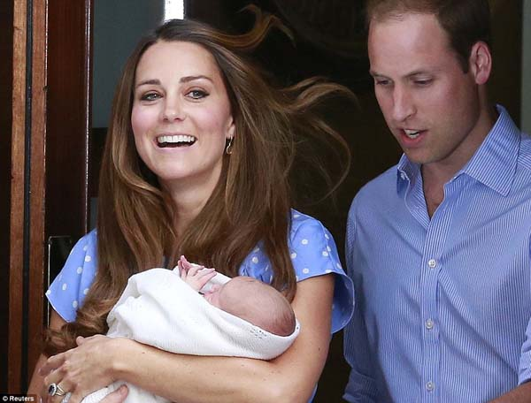 Prince William and his wife Catherine, Duchess of Cambridge, appear with their baby son Prince George.