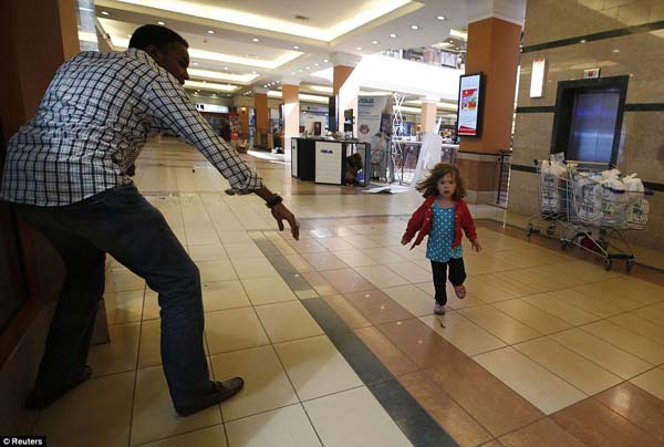 A child runs for help during the Westgate shopping mall shootings.