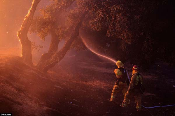 Firefighters fight a large blaze in California that destroyed more than 5,000 acres.
