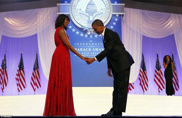 President Barack Obama bows to first lady Michelle Obama at the Inaugural Ball.