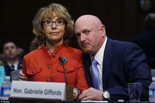 Former U.S. Representative Gabrielle Giffords delivers her opening remarks next to her husband.