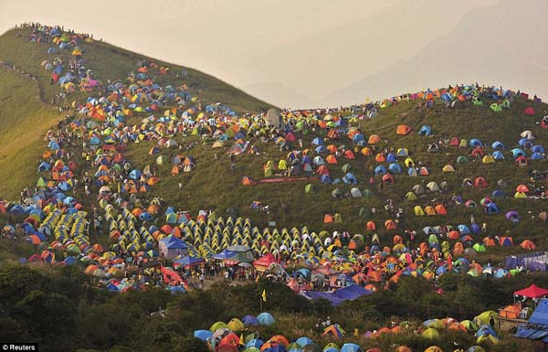 Tents cover the countryside in China during the national camping festival.