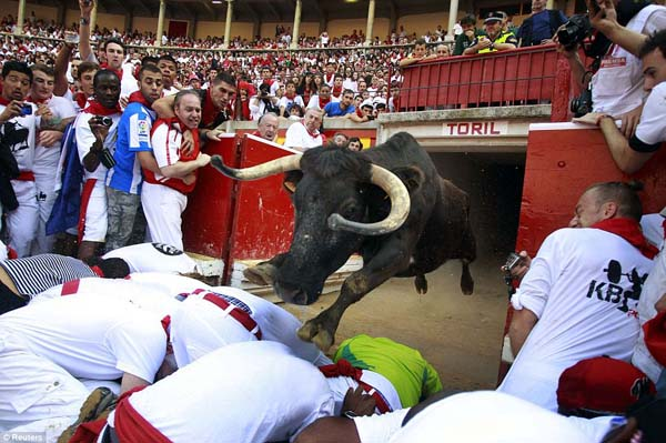 A fighting bull leapt over participants at the running of the bulls in Pamplona, Spain.